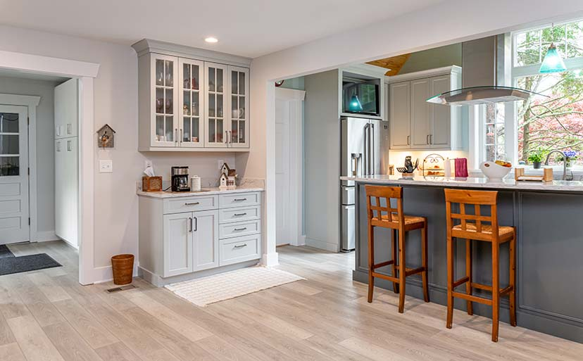 Craftsman Whole Home Remodel offers wood tile floors and a coffee nook