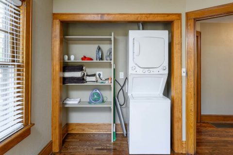 Convenient stackable washer dryer combo fits well into a laundry closet