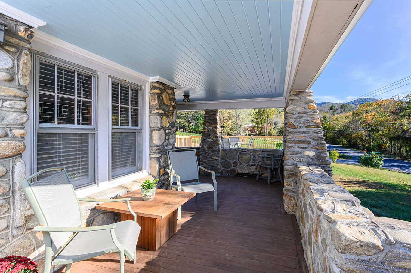 Expansive front porch with tongue and groove ceiling