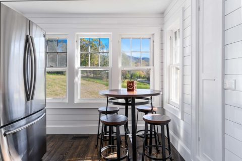 Breakfast nook with bar table and stools overlooks the beautiful Blue Ridge Mountains