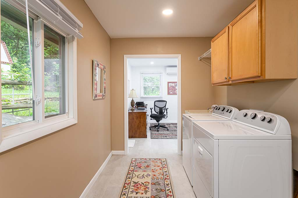 Mud room facilities for easy laundry days.