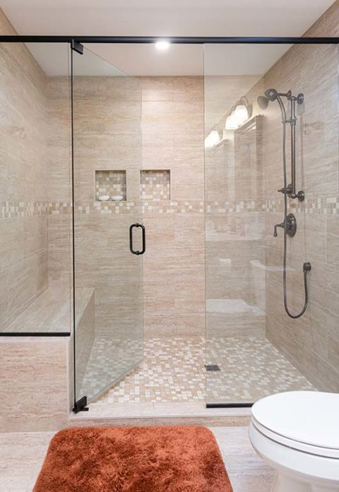 Clean Slate Renovation included a huge glass enclosed shower with intricate tile work,