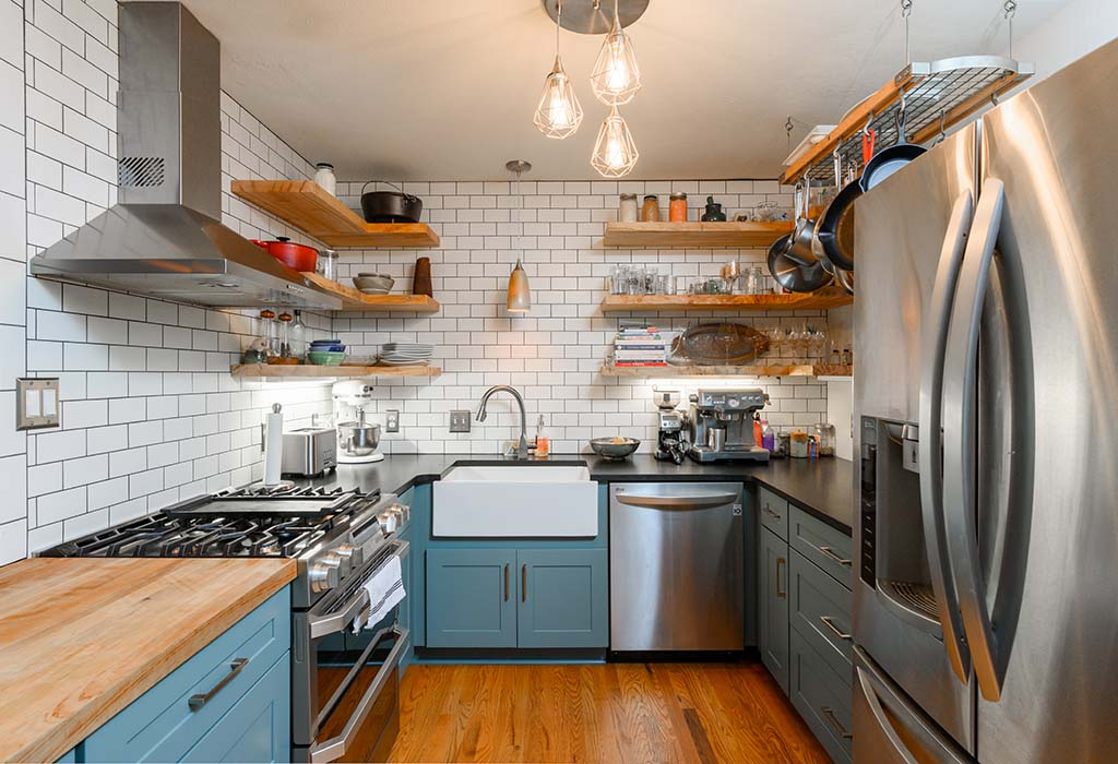 Modern Farmhouse Kitchen Remodel includes stainless steel appliances and a farmhouse sink