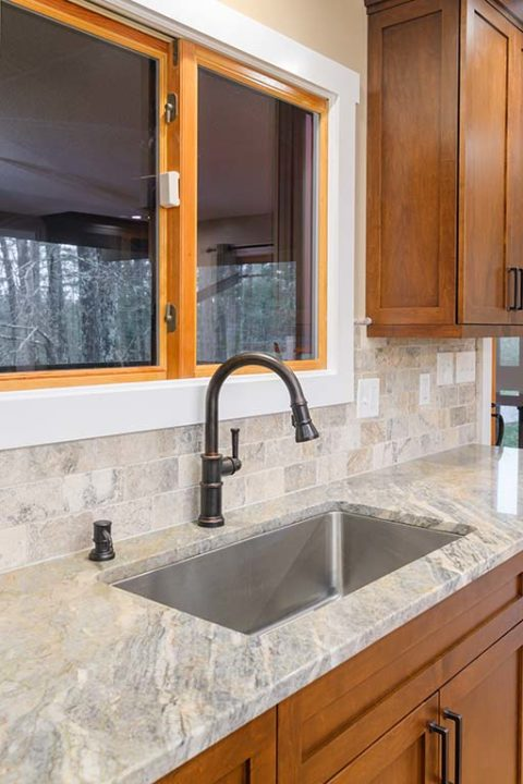 Recessed sink with antique nickel faucet