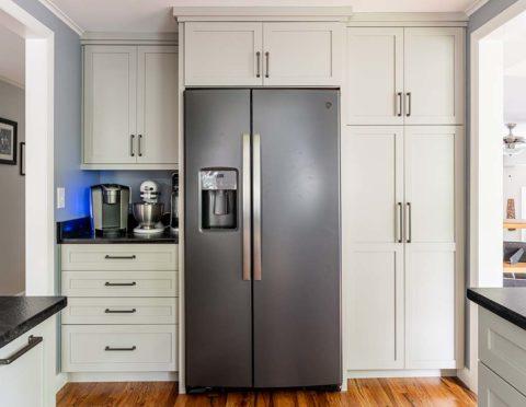 Semper Fi Custom Remodeling Kitchens - black stainless steel appliances compliment the white cabinets