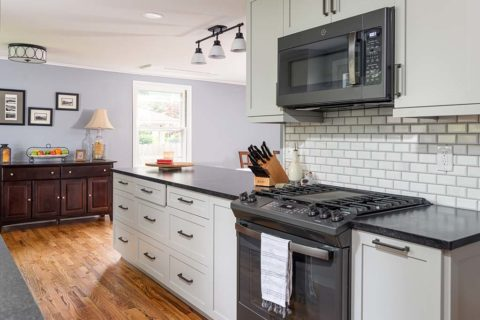 Semper Fi Custom Remodeling Kitchens - Classic white cabinets and a white subway tile backsplash make this home modern.
